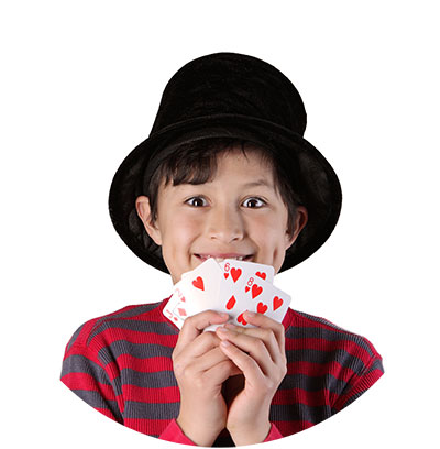 Boy Magician with a magic hat holding playing cards